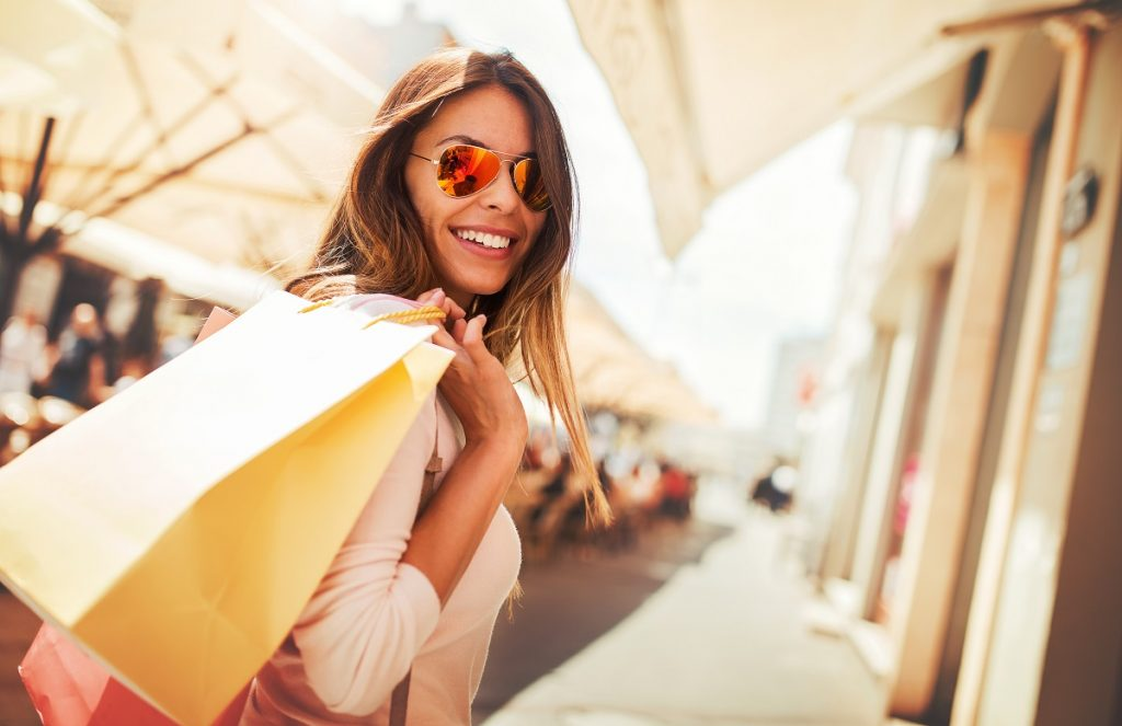 Woman smiling while shopping - small