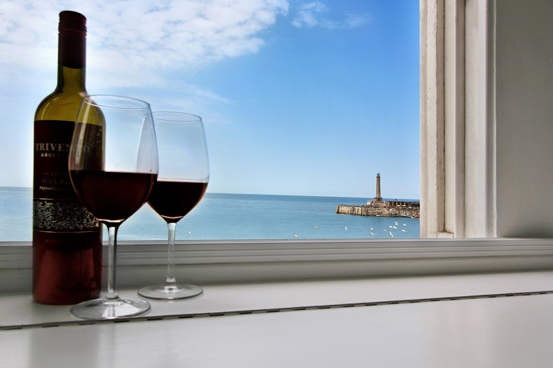 Take in the view over a bottle of wine. - Margate Airbnb